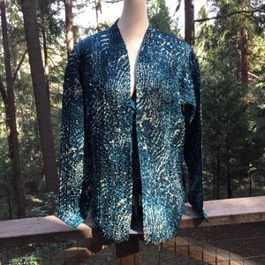 Scrunchy silky evening jacket is shades of blue.
